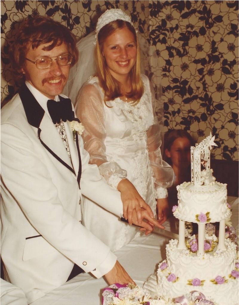 Cutting our wedding cake, 1974