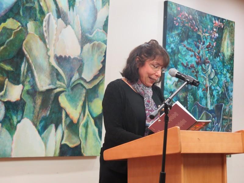Robin Kacel, associate editor, gives lovely reading